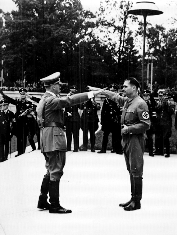 Adolf Hitler salutes Rudolf Hess at the opening of the 1938 Reichsparteitag